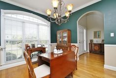 Traditional Dining Room with Pendant light, Crown molding, Chair rail, Hardwood floors, High ceiling