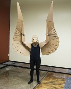 pterodactyl is lisa glover's second wearable cardboard creature, for more information visit her project on kickstarter.the pterodactyl is lisa glover's second wearable cardboard creature, for more information visit her project on kickstarter. Cardboard Costume, Cardboard Mask, Cardboard Sculpture, Cardboard Crafts, Paper Crafts, Cardboard Design, Cardboard Furniture, Fun Crafts, Crafts For Kids
