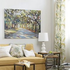 In Rick Reinert's Southern Oaks Stretched Canvas, Rich guides the viewer through a cathedral of Southern oaks with patches of golden light.