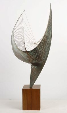Barbara Hepworth. This is a very elegant piece showing off her skill as a sculpture and really showcasing her talent with the big pointy, flowing shape and the layers of strings almost makes it look like it could be a type of instrument.