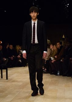 Pewter blue slim-fit wool and mohair-blend tailored jacket paired with black jersey slim-leg tracksuit trousers