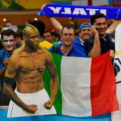 Italy+fans+hold+a+cardboard+cut+out+of+Italy%27s+forward+Mario+Balotelli+and+their+national+flag+as+they+celebrate+after+Italy+won+their+Group+D+football+match+against+England.jpg (1600×1600)