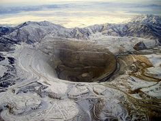 We used to live in Copperton, at the base of Bingham Canyon Copper Mine. The road up Butterfield Canyon will take you (in the summer) up to a mountain top on the Southwest corner of the mine with a great birdseye view of the mine and the Wasatch Front.