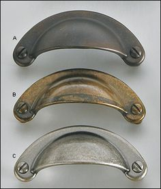cast round pulls hardware for the newly painted cabinet doors the one in the