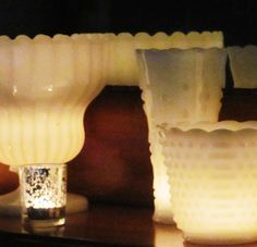 candles in milk glass