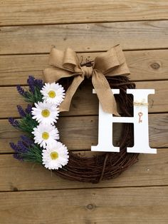 A personal favorite from my Etsy shop https://www.etsy.com/listing/279189436/daisy-lavendar-monogrammed-grapevine
