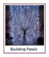 A wall of lights hangs behind this curtain to creating a stunning display.