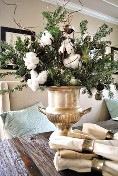Cotton and greens arrangement in silver bucket***I have this champagne bucket and use it for my little white Christmas tree, but this is very pretty for the rest of the year! All Things Christmas, Christmas Holidays, Christmas Crafts, Merry Christmas, Christmas Decorations, Xmas, Table Decorations, Holiday Decor, Lush Christmas