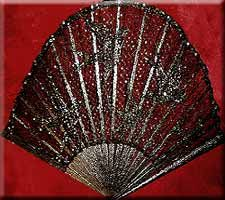 Shadow lace fan with blackbirds.