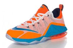 1ee3be2f47967 The Nike LeBron 12 Low GS Orange Blue White colorway is the latest kids  exclusive release of the low-top Nike LeBron This Nike LeBron 12 Low is  dressed