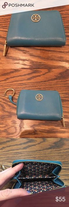 Authentic Tory Burch wallet Cute color. A few signs of wear but not noticeable. Such a convenient size. Great for travel and small purses and keys with the key chain feature Tory Burch Bags Wallets