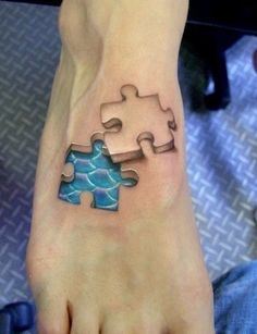 A puzzlish look for all the puzzle player lovers, the amazing 3d tattoo showing a puzzle piece in blue color that is dislocated its place and water inside the human's foot. Description from bigshocking.com. I searched for this on bing.com/images