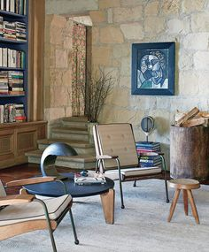 In Ellen DeGeneres's Tuscan-style house in Santa Barbara, the furniture's mid-century modern lines offer an interesting visual counterpoint to the rough-hewn stone walls and stairs.