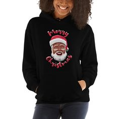Looking for the perfect Christmas Hoodie? A high quality sweatshirt featuring an image of an African American Santa Claus. I especially love the touch of snow on top of the words Merry Christmas. This hoodie really got the holiday spirit....word. Which color y'all feelin'? #blacksantaclaus #christmas #christmasdecor #blacksanta...