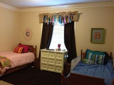boy girl shared room - I like the different style initials above each bed