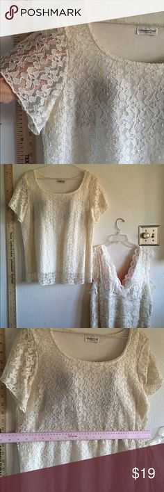 Sheer Ivory lace sleeves Coldwater creek large top Unworn pretty Ivory lace Coldwater Creek size large top with the sheer lace shorts leaves but lining on the bodice of the shirt original size tag removed unworn Coldwater Creek Tops