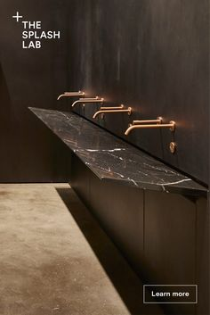 This incredible sink looks like a flat piece of black marble, yet water never flows over the sides. Learn how you can create a statement in your restroom with this large sink - perfect for office washroom interior design. Minimalist Bathroom, Modern Bathroom, Commercial Bathroom Ideas, Copper Faucet, Washroom Design, Next Bathroom, Public Bathrooms, Black Marble, Sink