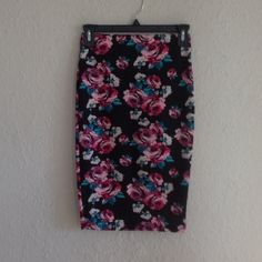 Floral pencil skirt Perfect condition. Stretchy material. Charlotte Russe Skirts Pencil