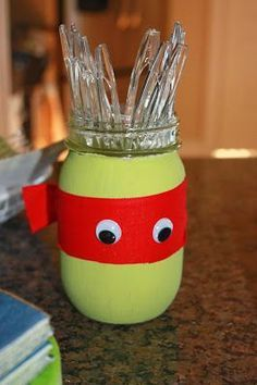 Easy DIY idea for a Teenage Mutant Ninja Turtles birthday party - masked containers to hold items such as cutlery or straws.