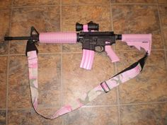Pink AR15 (before some asshat bitches - Guns do not kill people, people kill people, just like forks don't make u fat and pencils don't misspell words!)