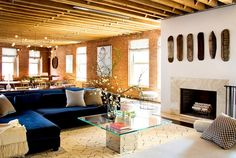 Sophisticated New York Loft - use instant granite over pieces of wood to create a faux/temp fireplace surround! BRILLIANT!