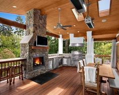 Built in outdoor kitchen, bar, dining fireplace and a tv - wow -traditional porch by Logan's Hammer Building & Renovation Other deck Covered Deck Designs, Covered Decks, Outdoor Rooms, Outdoor Living, Outdoor Kitchens, Outdoor Patios, Cabin Kitchens, Indoor Outdoor Kitchen, Patio Plan