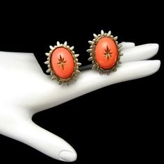 STRIKING ORANGE GLASS CLIPS! Vintage clip earrings with beautiful orange glass stones and carved stars. $34.95