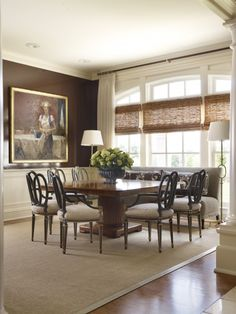 nice banquette along square table - love lacquered chocolate walls & simple shades with all this polished glamour