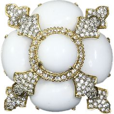 What an elegant and gorgeous brooch/pendant by the famed designer Kenneth Jay Lane. It features four large oval opaque white glass cabochons; set at