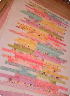 @Anorina Morris has designed a gorgeous twin bed quilt pattern that turns your jelly roll quilt fabric into a colorful series of strips. If you have any quilt scraps lying around from your last jelly roll pattern, this is a great way to reuse them.