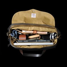 Laptop, notebook, magazine, sunglasses... What's in your Filson bag?