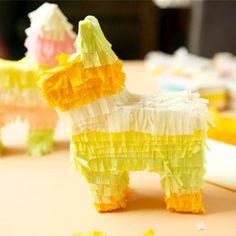 Instructions for how to make mini piñatas. (via ohhappyday)