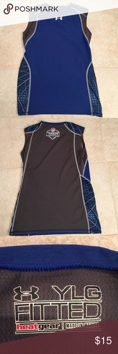 Under Armour Youth Large sleeveless heat gear Under Armour Youth Large fitted sleeveless shirt with NFL Combie Authentic patch on back.  Back is mesh like.  Cool print on sides and shoulders. Under Armour Shirts & Tops