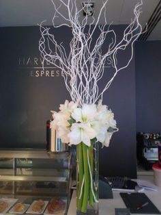 White decor branches with amaryllis flower, mine in green vases