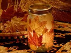Mason Jar Fall leaf Candle Holder  http://thegardeningcook.com/decorating-for-fall/