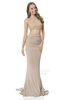 Two piece prom dress with boatneck beaded crop top and open v back. This prom gown is paired with a ruched jersey column skirt and back drape overlay. Visit www.meranski.com for more!