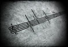 music keeps my heart beating. i love that concept of a heartbeat in the staff.