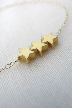 Gold Star Bracelet.  Would like to find one in a necklace with 4 stars.