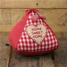 Home Sweet Home Triangle Doorstop - Polka Dots And Red Check Fabric Door Stop. This doorstop will accessorise any doorway and will definitely bring a shabby chic feel to your living spaces. Weighs under 1kg and stands 18cm high