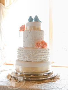 Vintage lace appliqué and fondant ruffles wedding cake with peonies