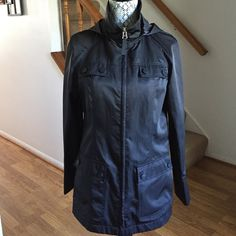 """Calvin Klein Black Hooded Rain Coat Size XS Perfect condition, this lightweight coat will keep you dry and warm. Shiny waterproof material, plenty of pockets, hood, and zip closure. Unlined, 100% polyester. Worn a handful of times. 28"""" long and 27.5"""" sleeve length. Calvin Klein Jackets & Coats"""