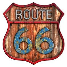 Old wood, chipped paint Route 66 sign