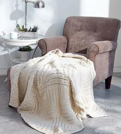 It seems like every knit blanket pattern today is made up of only one or two different stitches. If you're a knitter who likes their projects to have a bit of pizazz, the Modern Elegance Knit Blanket is right up your alley.
