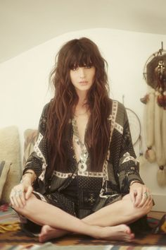Long wavy brunette hairstyle with blunt heavy bangs
