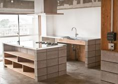 Tank Architects // House K // Minimalist Elegance in the Kitchen, concrete kitchen with stainless top and plywood shelves