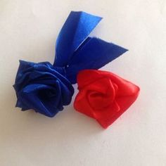 How to make a simple ribbon rose via @Guidecentral - Visit www.guidecentr.al for more #DIY #tutorials