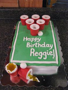 """Beer pong birthday cake - Made for a friend's birthday.  Chocolate cake, RK cups covered in fondant.  """"beer"""" is piping gel, fondant balls.  Thanks to others on CC for inspiration."""