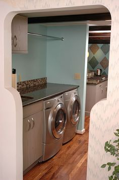 A back hallway off of a kitchen was creatively and efficiently designed as a laundry room by Neal's Design Remodel.