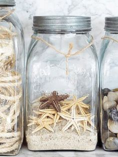 Create your own beach. Display a collection of starfish, beach stones, shells and rope in clear mason jars.