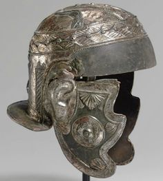 A ROMAN IRON AND TINNED BRONZE CAVALRY HELMET   CIRCA SECOND HALF OF 2ND CENTURY-EARLY 3RD CENTURY A.D.   Formed of iron with tinned bronze overlay decoration